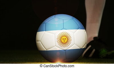 Football player kicking Argentina flag ball - Football...