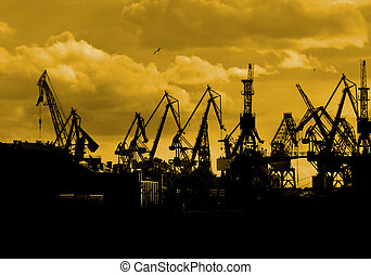 Sea port - Silhoueete of sea port cranes in the morning