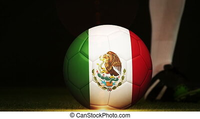 Football player kicking Mexico flag ball - Football player...