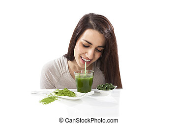 Beautiful girl drinking green juice - Beautiful smiling girl...