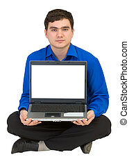 Guy sits on a floor with the laptop