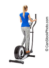 Young woman uses elliptical cross trainer