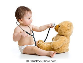 kid boy playing doctor with toy
