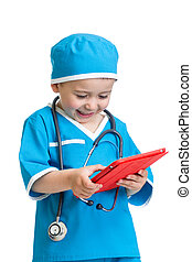kid boy uniformed as doctor with tablet pc in hands