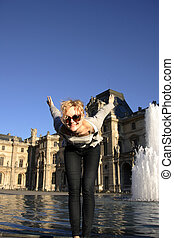 young pretty caucasian lady having fun at an outdoor water...