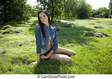 Sexy model in jeans clothes