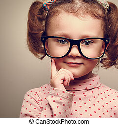 Closeup portrait of fun happy kid girl in glasses Vintage