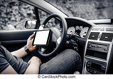 Car driver with the Tablet PC - Man in the car, with the...