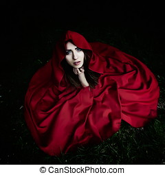 woman with red cloak in the woods - beautiful woman with red...