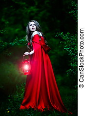 beautiful woman with red cloak in the woods - beautiful...