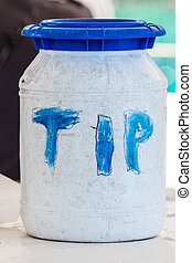 tip-box - close-up picture of a big plastic tip-box in the...