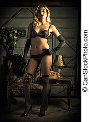 Sexy Blonde Woman in Black Lingerie - A young, attractive...