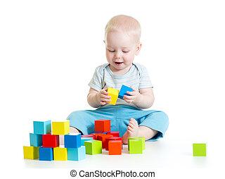 Child boy playing toy blocks isolated on white background