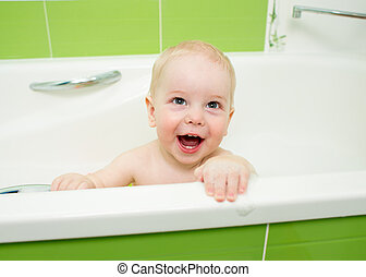 baby boy taking bath and playing with toys