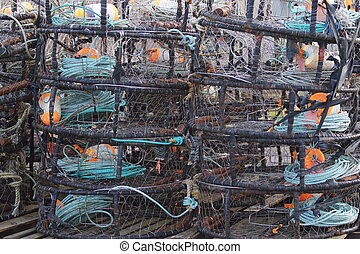 Crab Traps 1 - stack of crab traps late in the evening on...
