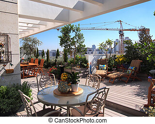 Beautiful blooming rooftop garden in city setting -...