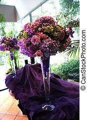 Decorative Flower Arrangements on Purple Tablecloth - Image...