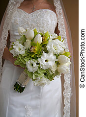 Bride Holding Bouquet of Green and White Flowers - Image of...