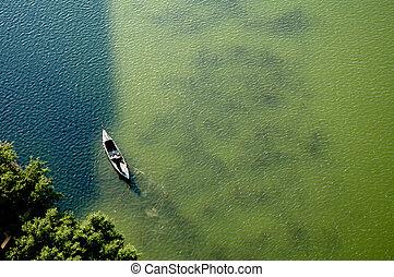Aerial View of Canoe on Lake - Image of a person rowing a...