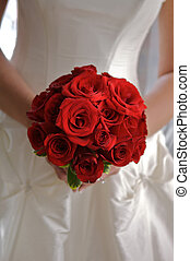 Bride Torso Holding Bouquet of Red Roses