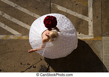 Bride Twirling in Parking Lot - Image of a bride twirling...