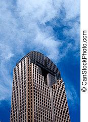 Tall Skyscraper on Blue Sky Background