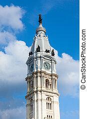 Philadelphia city hall tower over a cloudy sky -...