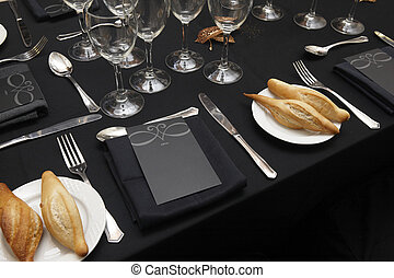 Black decorated table ready to be served. Horizontal