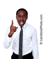 Portrait of angry african businessman over white background