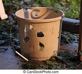 Bucket destroyed by hail - Home-related item, a bucket,...