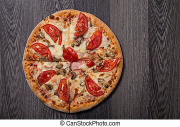 High angle view of delicious Italian pizza with ham and...
