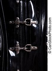 Close-up shot of metal corset clasps