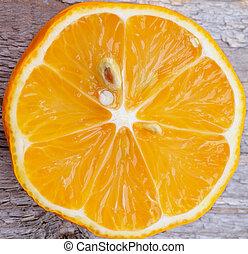 Tangerine - Slice of Fresh Ripe Tangerine Cross Section...