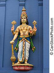 Statue of  Vishnu on Hindu temple wall