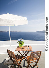 view from house patio of volcanic islands of santorini -...