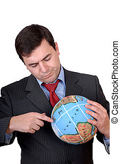 globe - business man holding a globe in white background