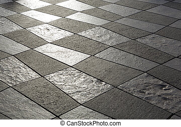 Pavement built of white and black stone slabs - Detail of...