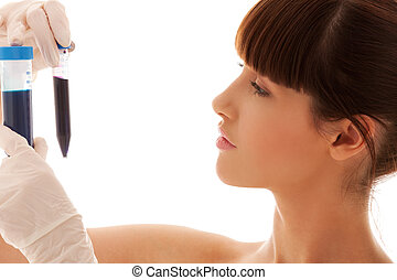 lab work - beautiful female lab worker holding up test tubes