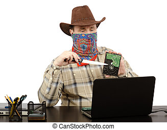 Threatening by knife and hard disk - Burglar in cowboy suit...