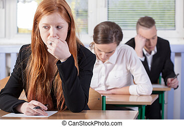 Students during exam - Horizontal view of students during...