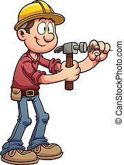 Hammering nail - Construction worker hammering a nail....
