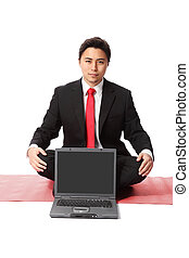 Serious businessman with computer