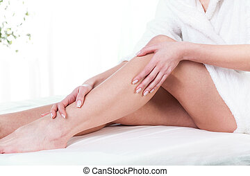 Female legs after massage on isolated background