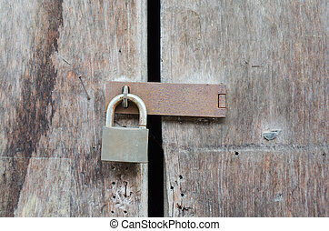 Door locked by rusty padlock