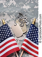 American Flags and Dog Tags - Closeup of two crossed...