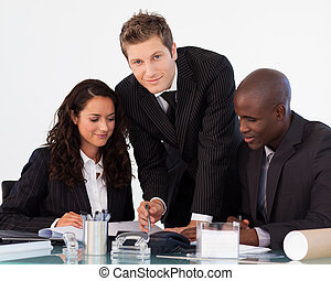 Young businessman working with his team