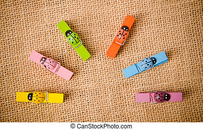 many color wood clamps on sack background