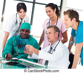 Medical team discussing in an office in a hospital
