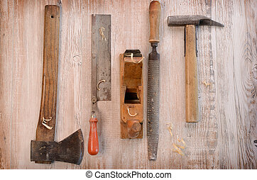 Carpenter tools - Old used carpenter tools on a wooden...