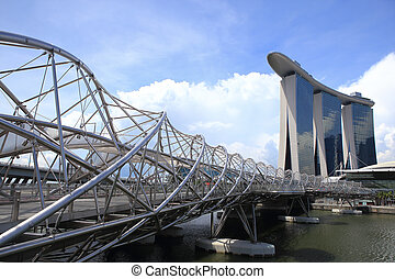 The Helix Bridge and Marina Bay Sands - SINGAPORE - MAY 10:...